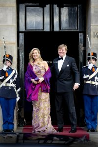 King Willem Alexander and Queen Maxima standing outside